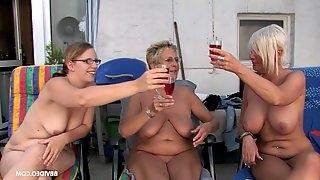 Mature short haired MILF babes get facials in an outdoor orgy