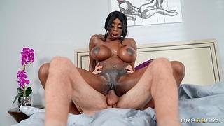 Busty black chick Swart Mystique enjoys having interracial sex